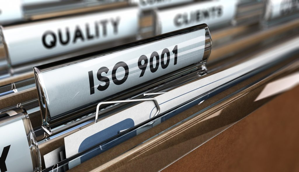 File tab with the word ISO 9001 as the main focus. Concept image for Quality Standards illustration on Compliance Management software page.